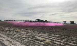 A sprayer using dye to test the accuracy of USQ's weed maps.